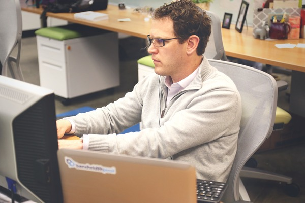 Single marketer working at computer