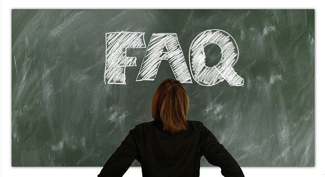 Woman looking at chalkboard with FAQ